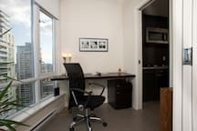 View to the modern office, accessible from living area and kitchen. Pocket doors for complete privacy.