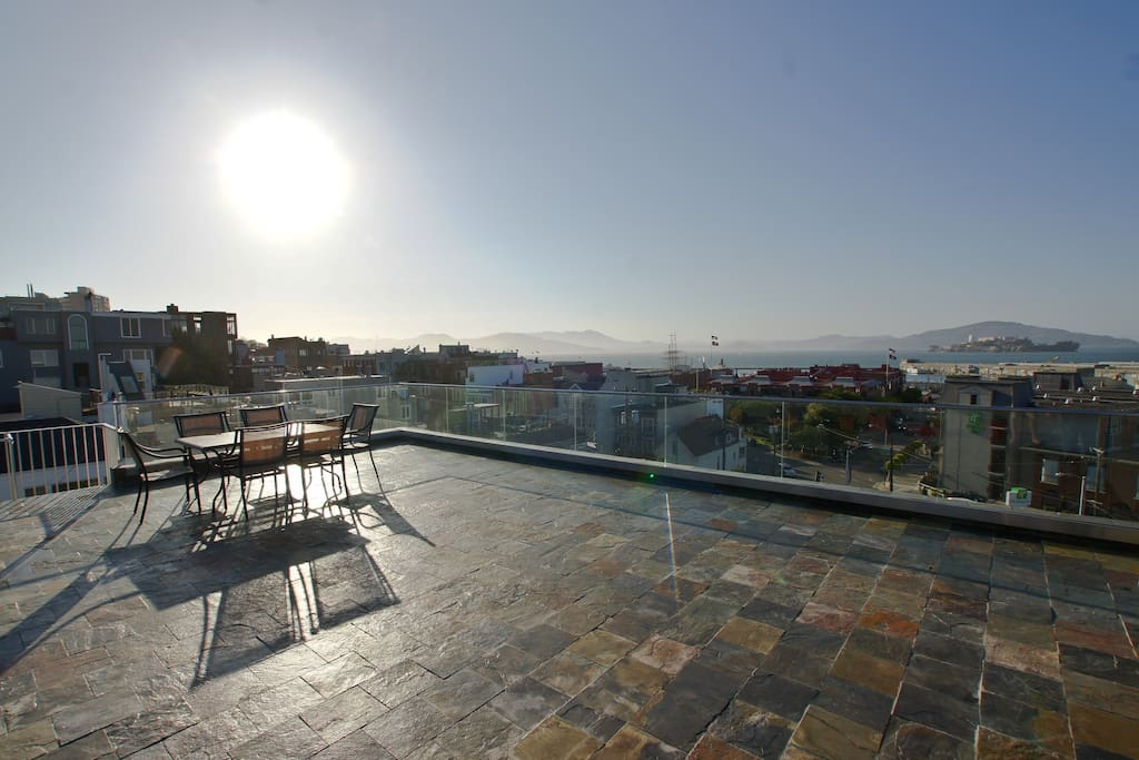 View from glass enclosed roof deck (Large table and BBQ for guest to use as they please)
