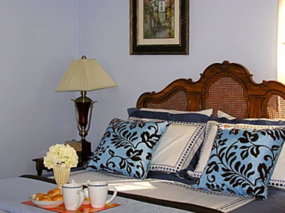 Master bedroom on the 1st floor features a king bed and a sitting area with couch and TV/DVD combo