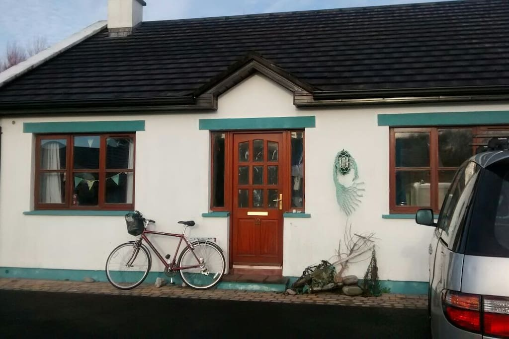 Front of the house with one of the bikes that are available to explore the Wild Atlantic Way