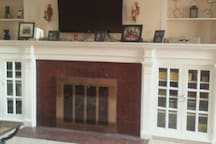 Living Room with gas fireplace and piano