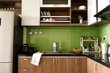 Full kitchen with coffee machine, toaster, microwave and cooker
