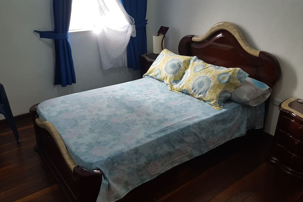 Private room with queen size bed and street view