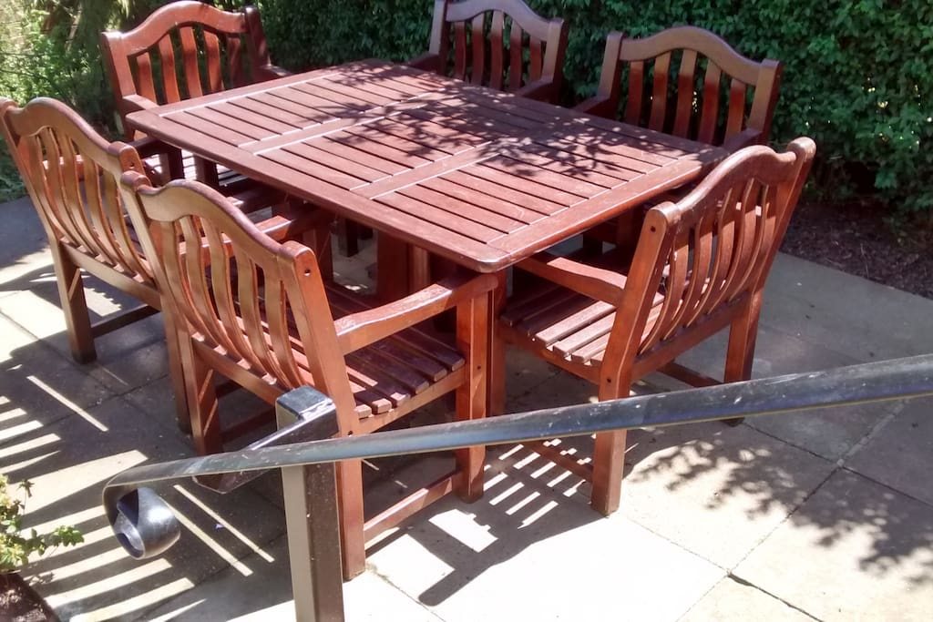 A set of steps leads to the outdoor dining area , there is also a bistro set  on the patio
