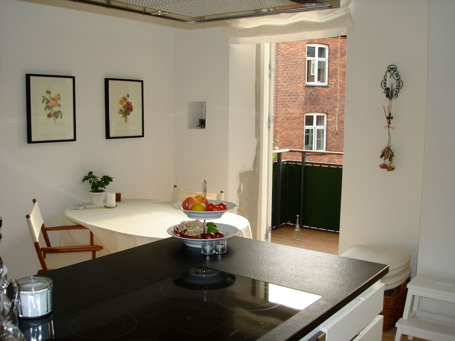 Bright kitchen with access to west turned balcony