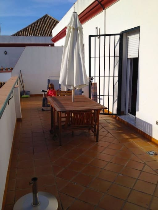 Nice terrace with table, chairs and sunbeds