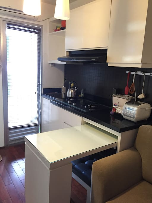 The small kitchen, complete with all appliances and utensils and a small rice cooker! Dining table can be expanded.