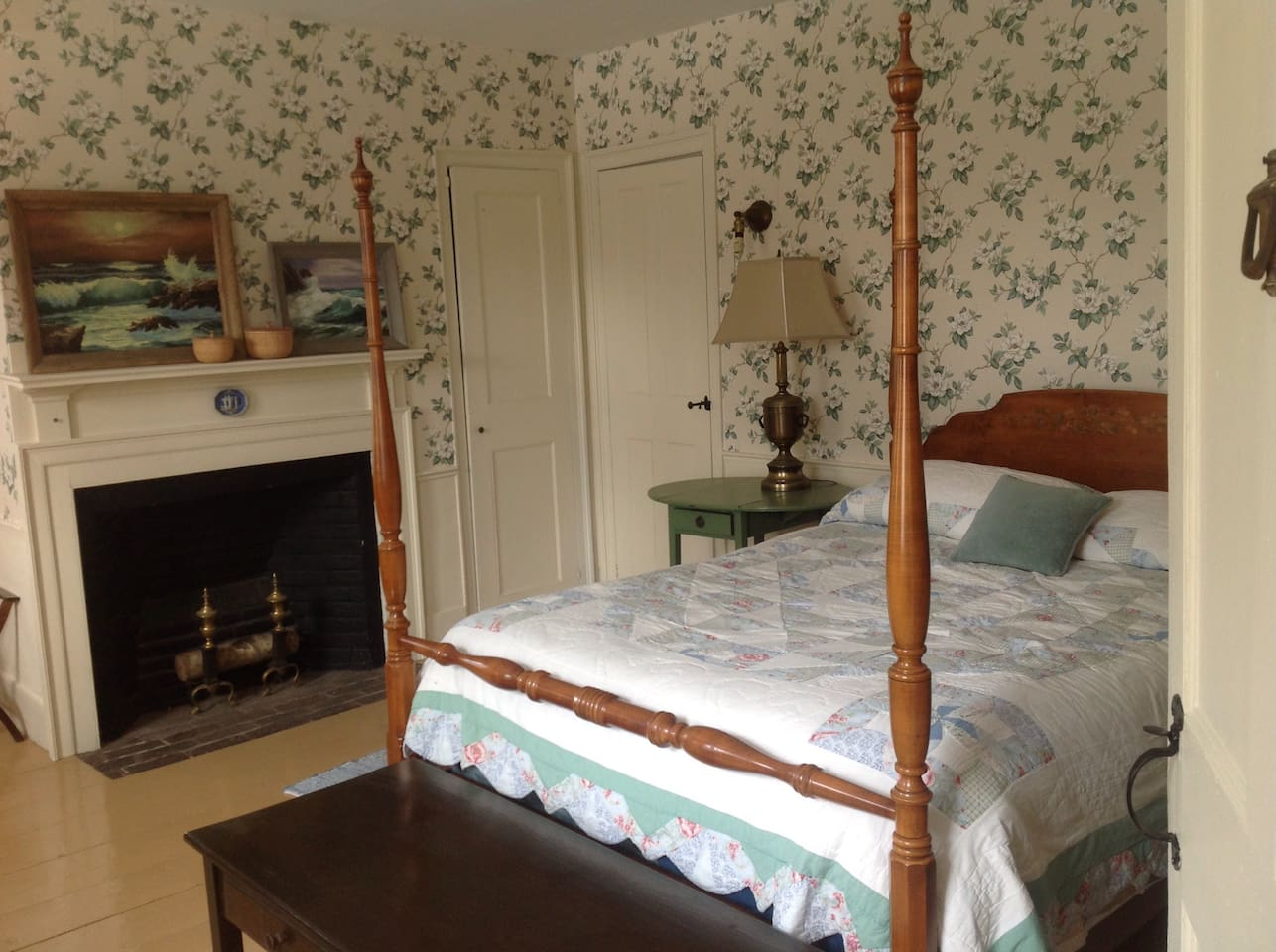 Double bed with colonial decor.