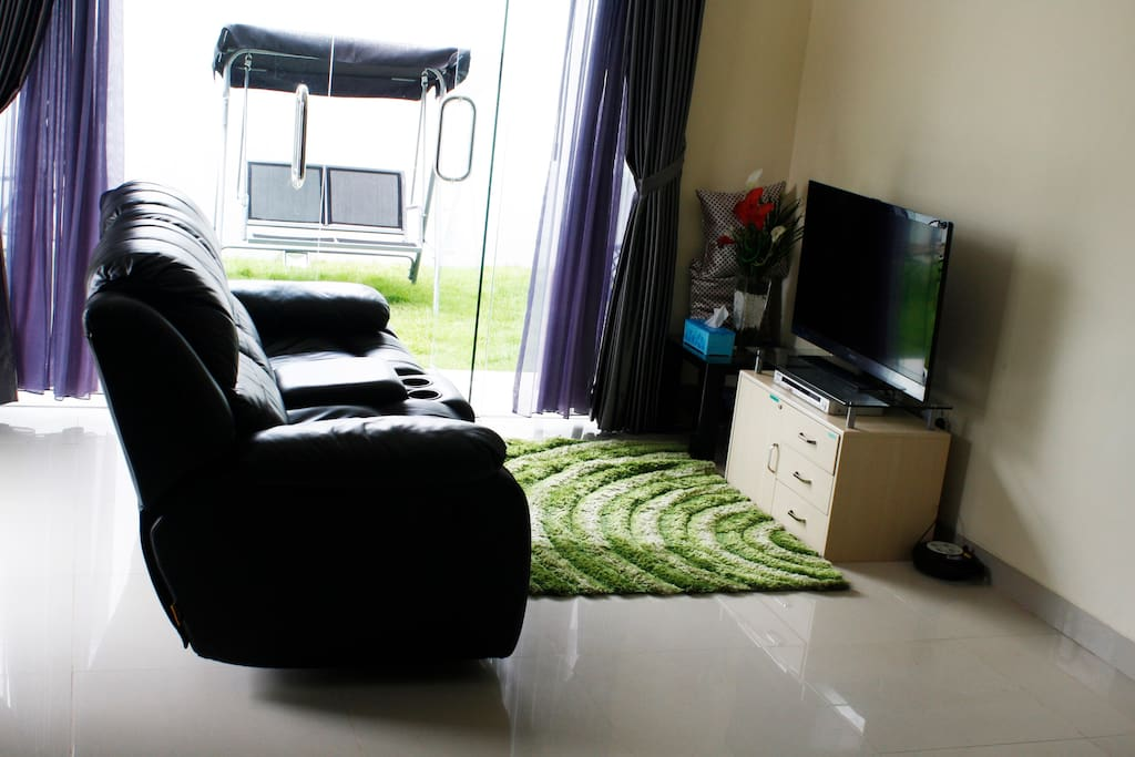 Our Living room served with garden view and children playground