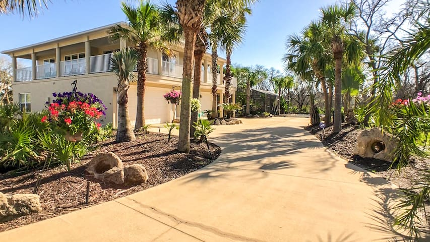 Oasis by the Sea Beach front community luxurious pool home with Waterfall Sleeps 10