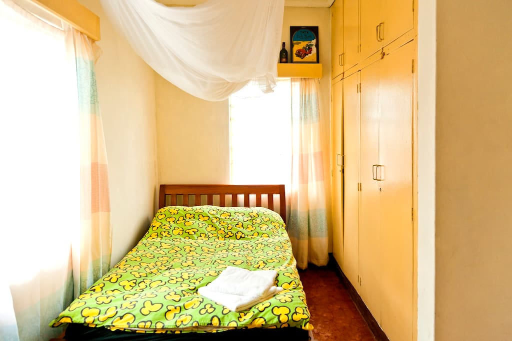 Room 1, Mosquito net and enough space to stow your belongings in the fitted wardrobe