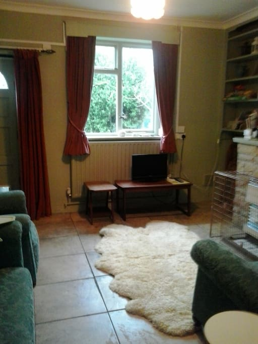 Southerly aspect sitting room with supplementary gas fire & tv + dvd player
