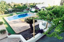 View to the pool and garden