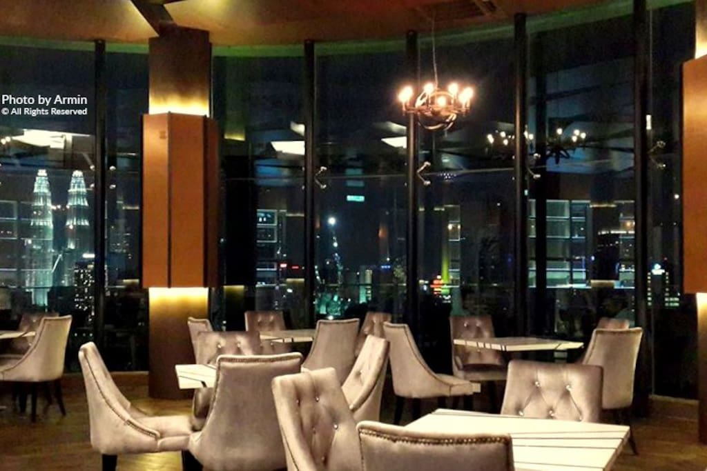 Bar/Restaurant just beside pool at rooftop, with Twin towers view
