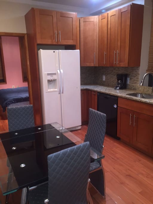 Gourmet kitchen with dishwasher table and chairs