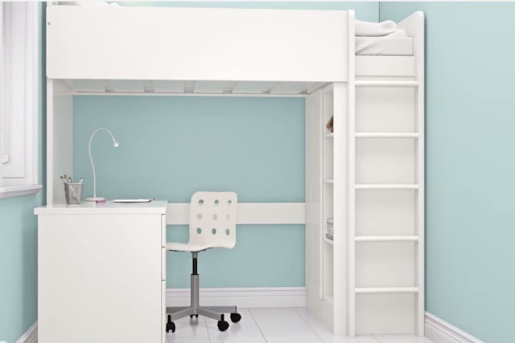 This is a picture of the bed as shown on the manufacturer website. It features a twin (single) loft bed, a desk underneath with extra drawer space, as well as a wardrobe and shelves to hold your clothing and personal belongings.