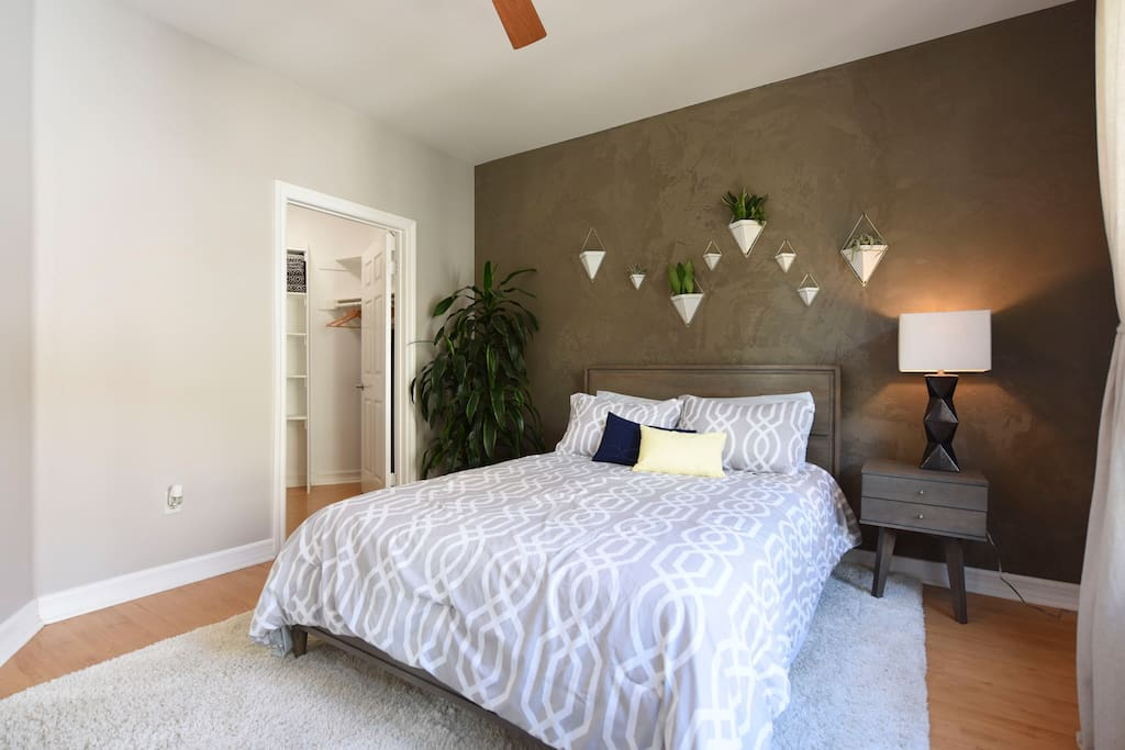 The bedroom is spacious with walk-in closet, flat screen TV, and queen size bed.