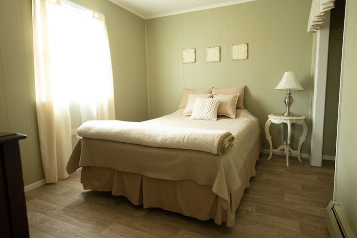 Queen sized bed, with linens provided. Closet has hangers. Guests may use drawers in dresser.