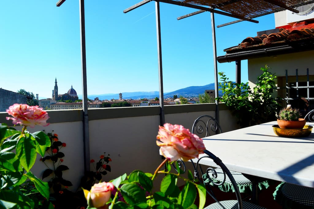 Terrace view of the Duomo of Florence with Roses