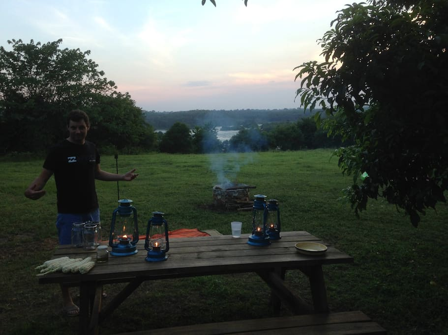 Bbq, picnic table, lamps and sunset