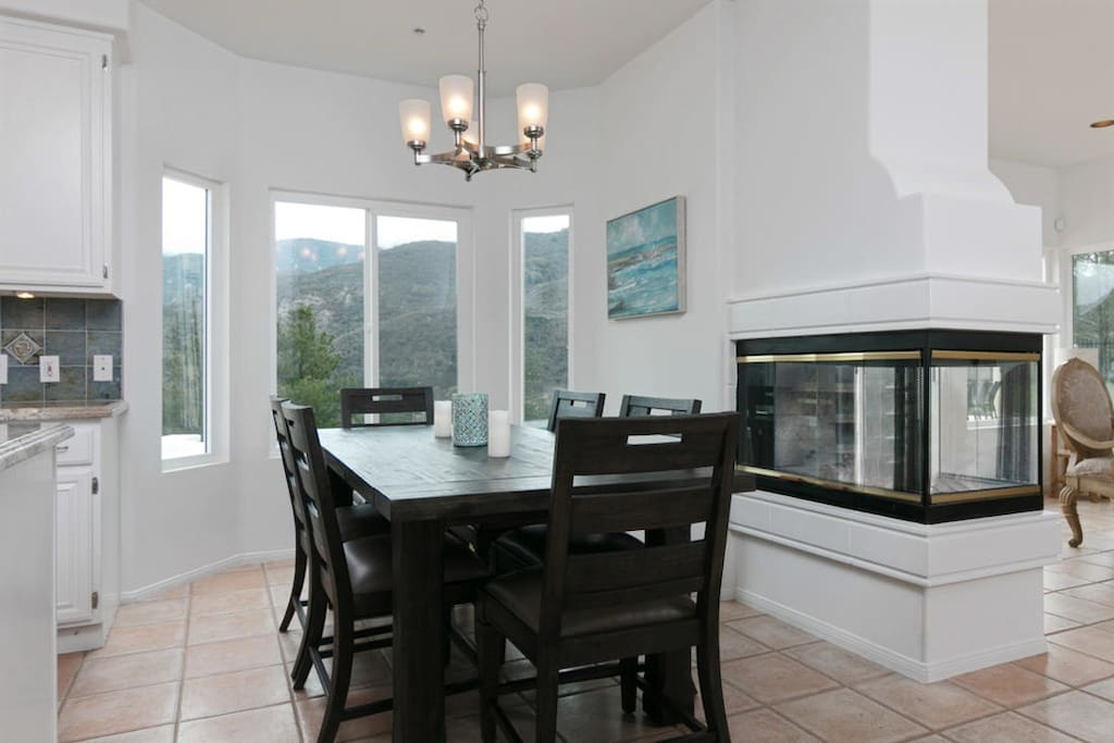 A lovely, dark wood kitchen table offers additional seating for 6.