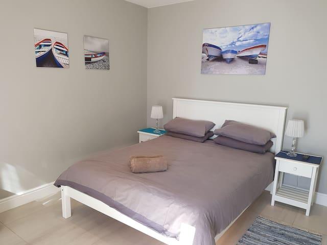 Bedroom includes wardrobe.