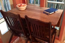 Antique oak table folds down into a tiny sliver if you'd like more room