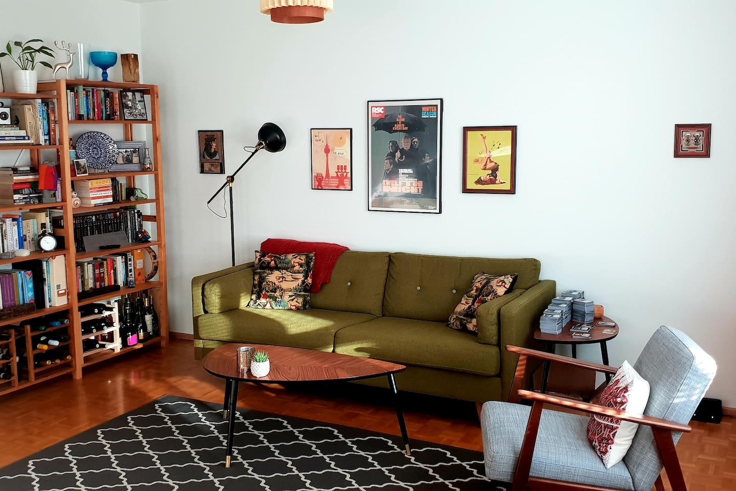 Shared living room with a midcentury modern style. Throw a record on and make yourself at home.