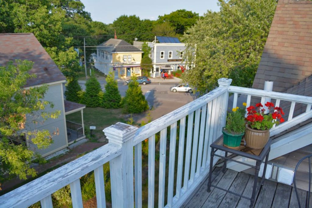Private deck overlooking charming Willard Square.