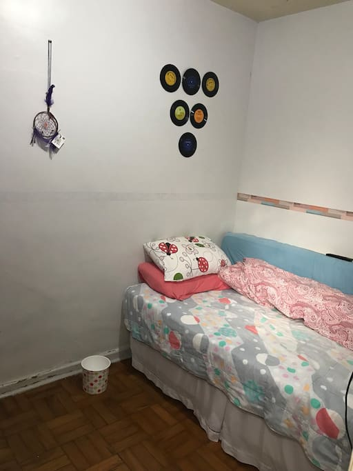 The room, it looks small but is perfect for someone who is just looking for a place to rest