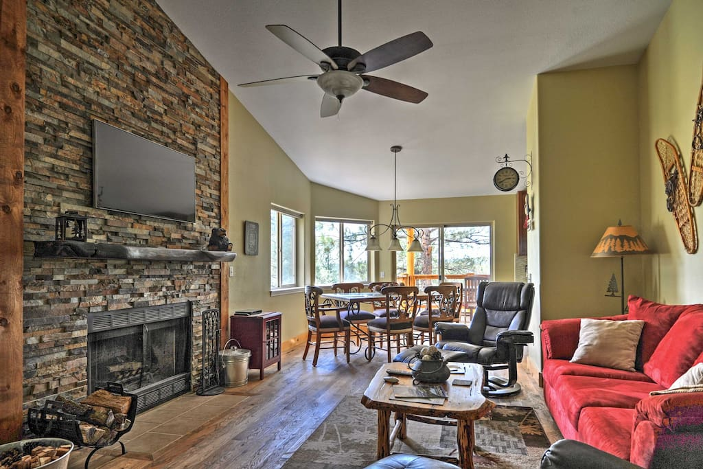 This charming 3,104-square-foot home features rustic decor & a stone fireplace.