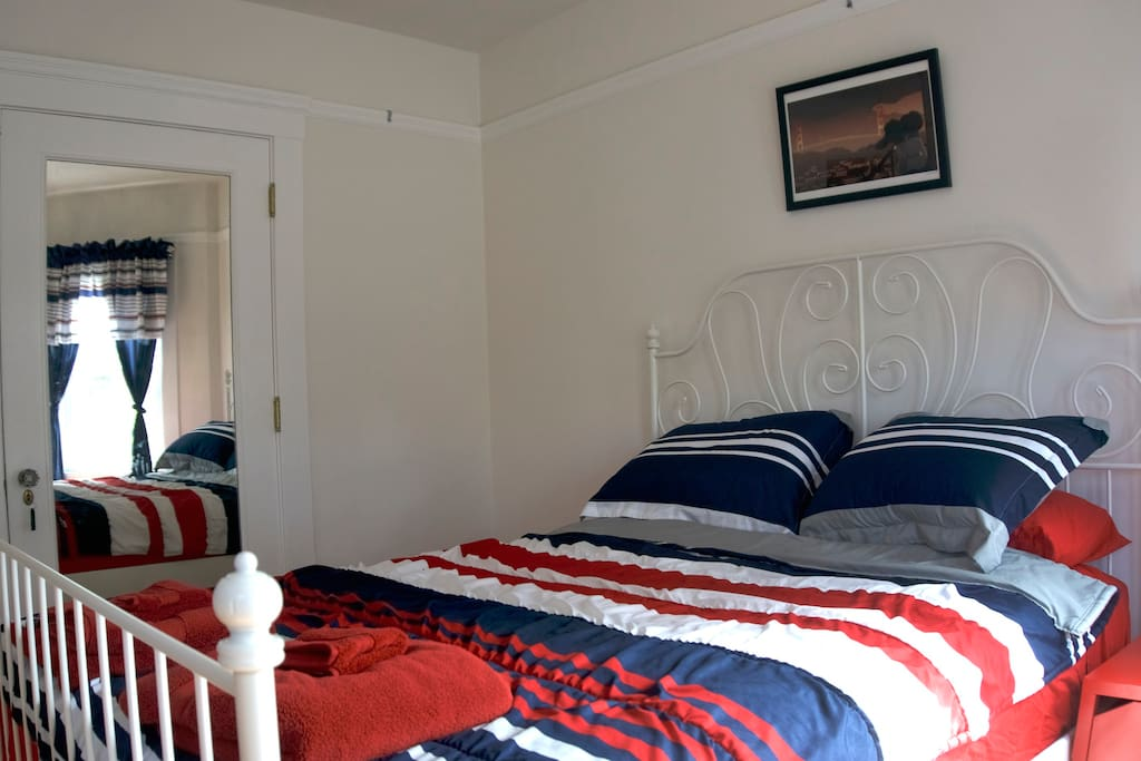 Your bedroom with a queen-sized bed, 2 nightstands, closet and classic bay windows