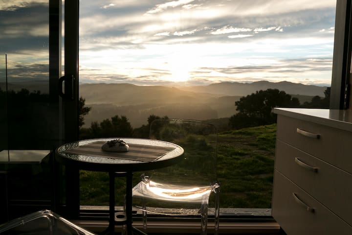 Watch the sunset over the rolling hills