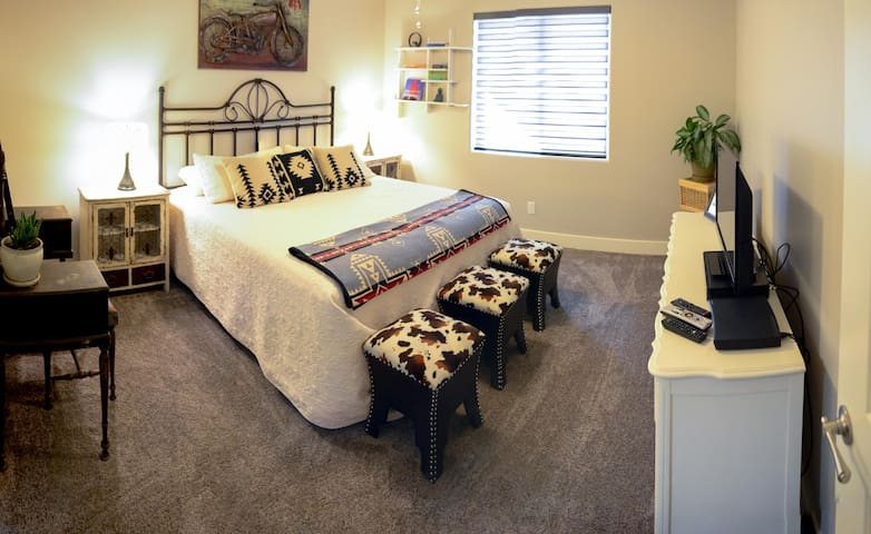 Master bedroom with cable tv and great view of the garden and vermillion cliffs!