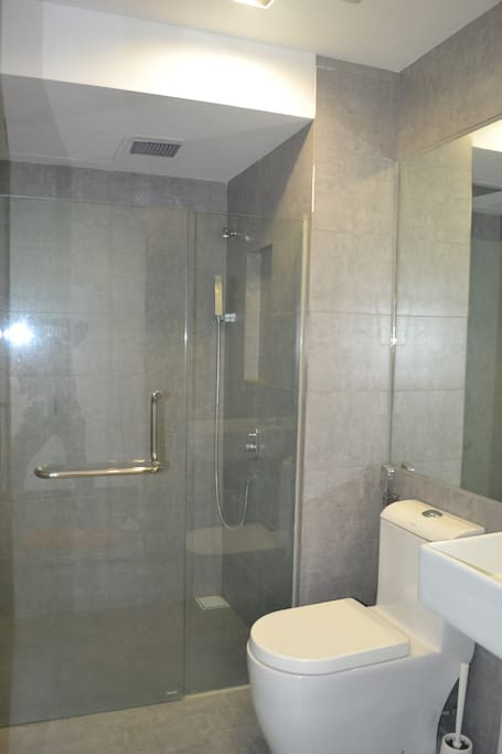 Bathroom with heater and overhead shower