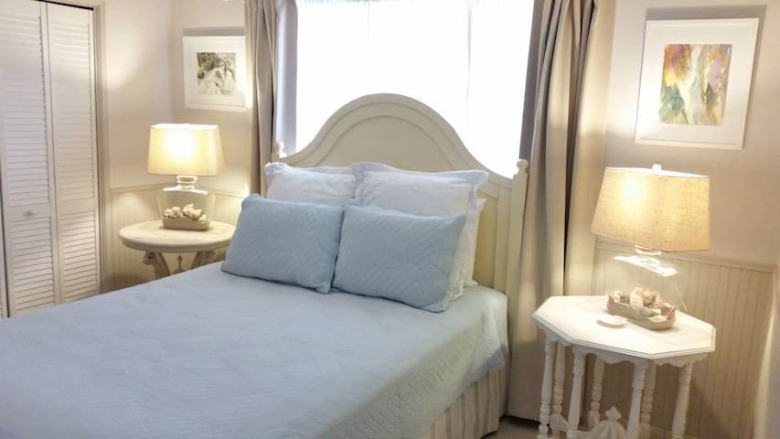 New decor with summer linens on the Euro Pillow Top queen size bed with blackout drapes for a restful night's sleep.