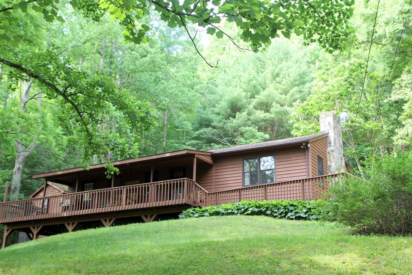 Spacious cabin with full wrap-around porch on nine acres  in remote setting