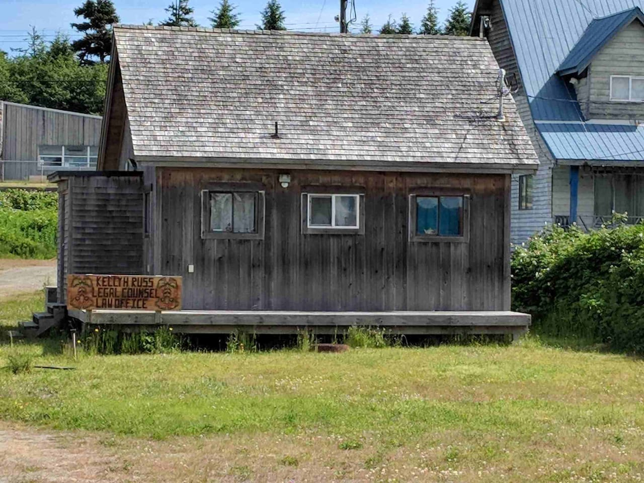 This is the exterior of the cabin which is a law office once per month.