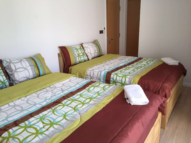 Fabulous twin bedroom with 2 double beds, private balcony and ensuite bathroom. Perfect for all of the children or a family together.