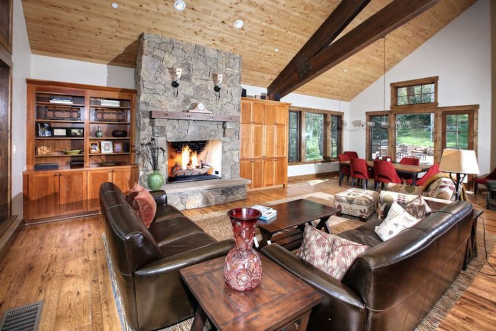 contemporary family room with dining room,  built ins, fireplace and tv.