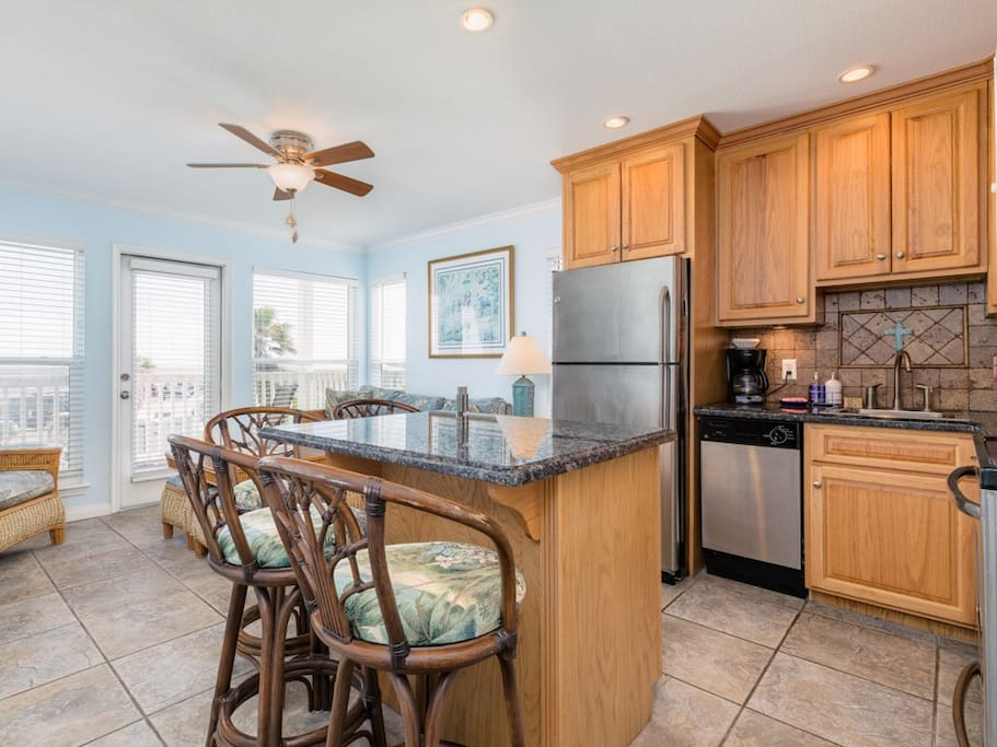 The kitchen has a granite countertop island and a full suite of stainless steel appliances.