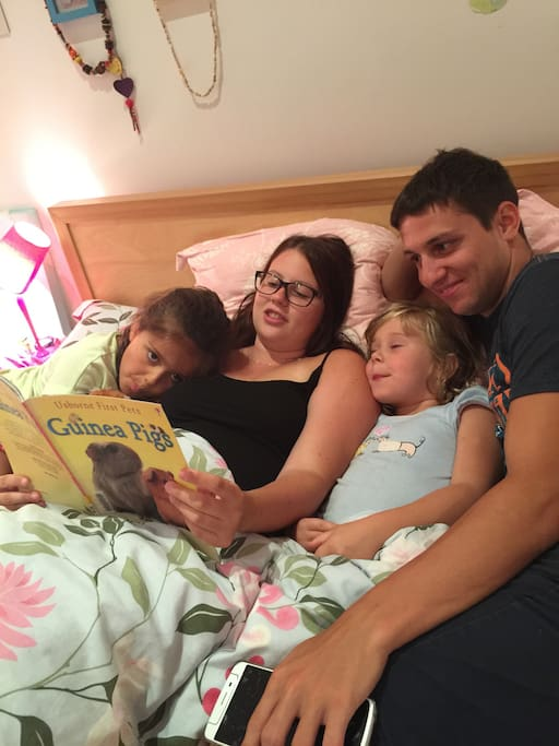 Our Help Exchange couple reading the kids a bed time story.