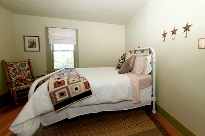 Northeast bedroom--Cozy and comfortable.  The bed was originally from a farm just up the road.