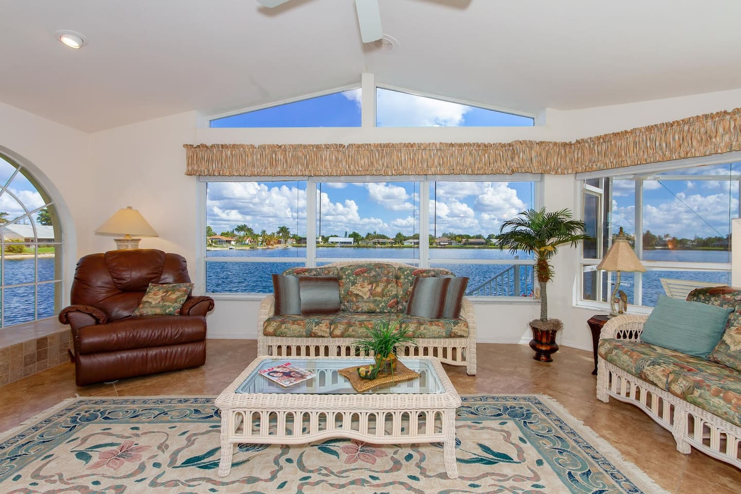 Sun-flooded Florida room with huge windows