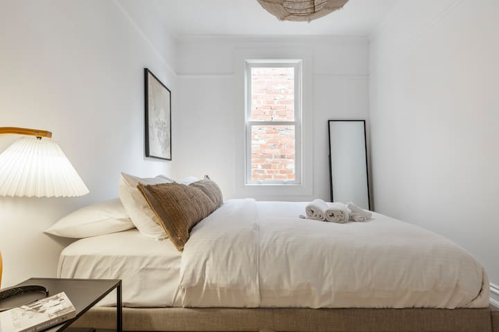 The second bedroom is just as comfortable as the first, incorporating eclectic lighting, simple artwork and a full-length mirror for your convenience.