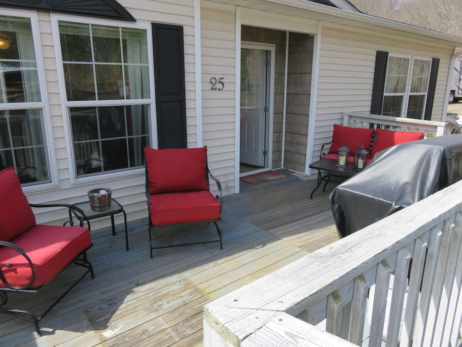Front deck with patio furniture and gas grill