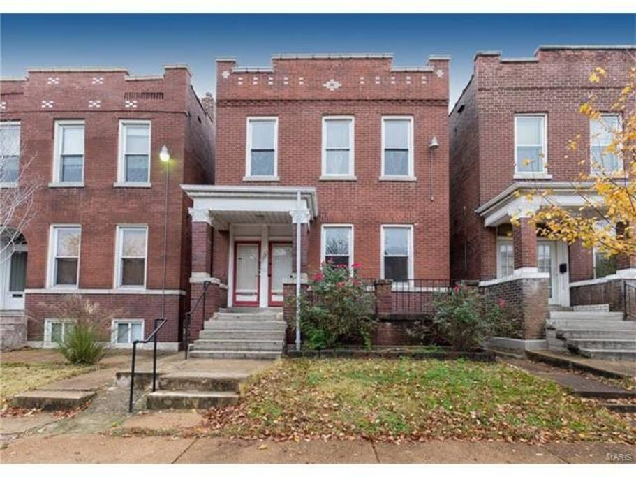 The Zen Nest occupies the upper unit of this charming and classic St. Louis brick home.