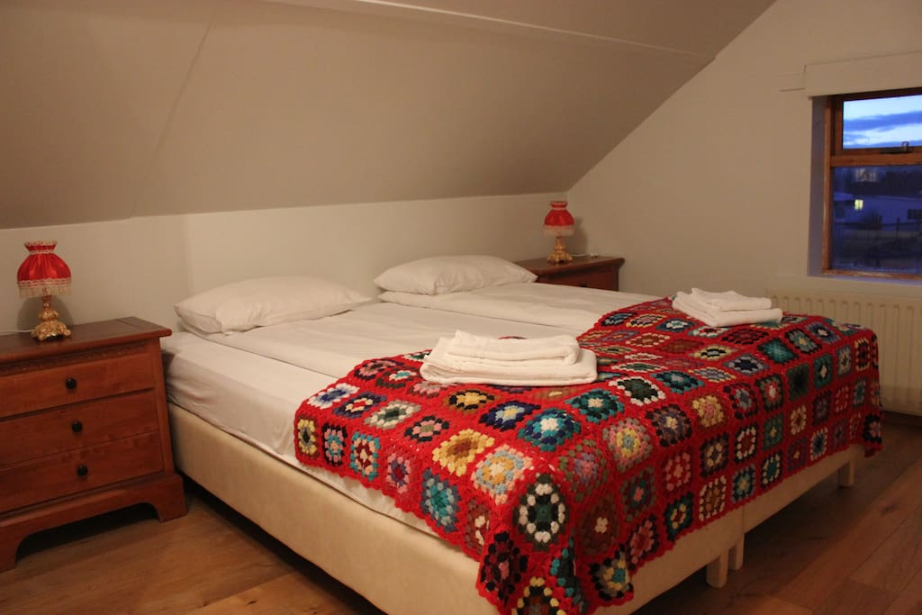 Sleeping loft with two single beds.