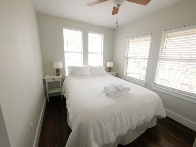 Bedroom looks over the treetops--so romantic! Plus, a clean and minimalist design aesthetic.