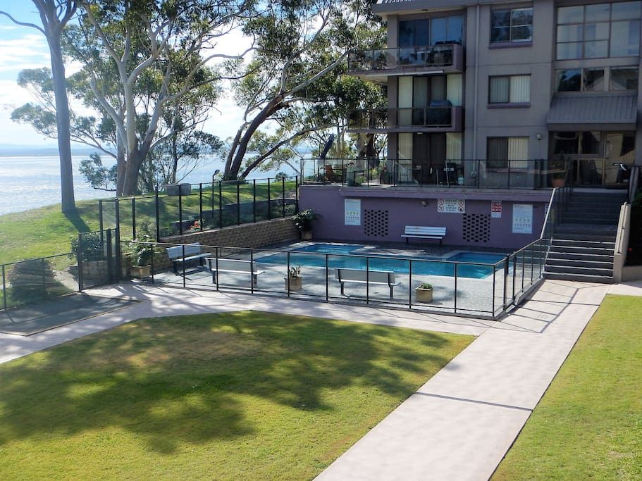 Watch the kids in the pool from your balcony.
